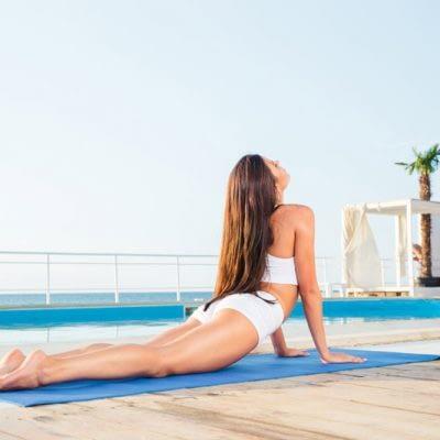 woman-stretching-on-yoga-mat-PW6S337.jpg