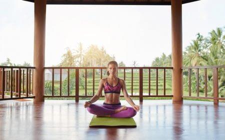 young-woman-meditating-in-lotus-yoga-pose-PAGL35E.jpg